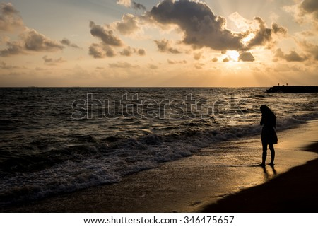Alone and sad at the beach before sunrise silhouette style background