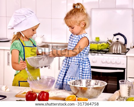 Alone children  breakfast at home kitchen - stock photo