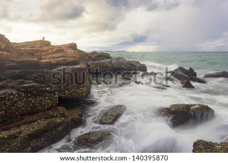 Alone human in the seascape - stock photo