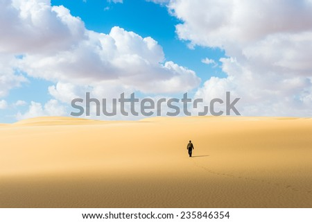 Alone man in the Sahara desert in Egypt - stock photo