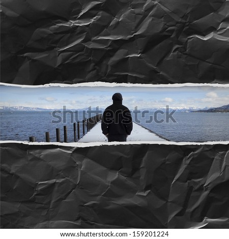 alone man in the snow in paper hole background