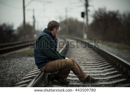 alone man on railway - stock photo