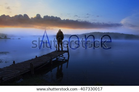"alone man watching sunrise near lake, conceptual poster with word ""alone"" added"