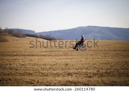 Alone old woman on wheelchair - stock photo