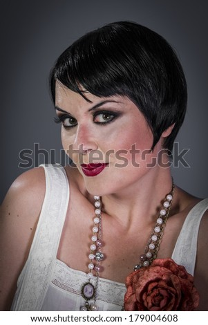Alone, Retro posing lady,  flapper dress, Girl dreaming beautiful young woman from roaring 20s looking at camera.  vintage twenties - stock photo