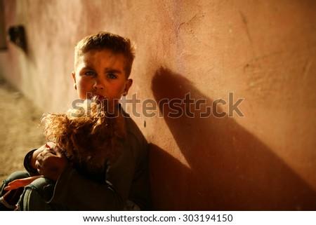 alone sad child playing on a street - stock photo