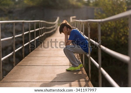 alone sitting in a sad way helpless child