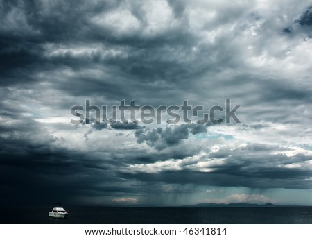 Alone white little boat in sea with storm weather - stock photo