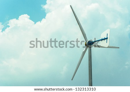 alone windmill with big clound - stock photo