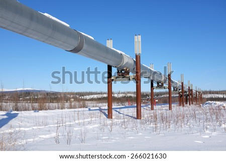 ALONG DALTON HWY, ALASKA-MARCH 2, 2015:  Alaska's North Slope oil pipeline carried 7% less crude oil in Jan. 2015 vs Jan. 2014 and 70% less than Jan. 1985. The pipeline is shown as of March 2, 2015. - stock photo