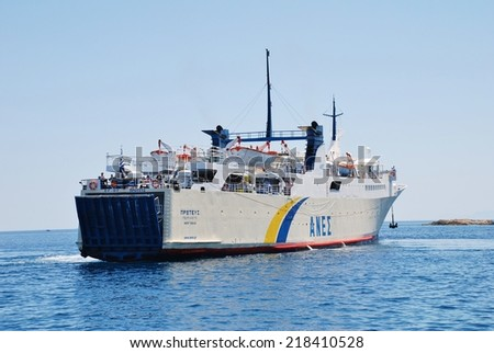 ALONISSOS, GREECE - JUNE 23, 2013: Anes Lines ferry Proteus arriving at Patitiri harbour on the Greek island of Alonissos. The 87.91mtr ship was built in Greece in 1973. - stock photo