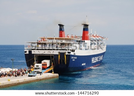 ALONISSOS, GREECE - JUNE 26: Hellenic Seaways ferry Express Pegasus unloading at Patitiri harbour on June 26, 2013 on the Greek island of Alonissos. The 125.7 mtr long ship was built in 1977 in Italy. - stock photo