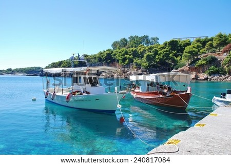 ALONISSOS, GREECE - SEPTEMBER 23, 2012: Small boats moored in Rousoum harbour on the Greek island of Alonissos. Rousoum was once the centre of the islands wine exporting trade. - stock photo