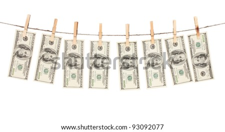 Alot of one hundred dollar bills is hanging on a rope with wooden clothespin isolated on white - stock photo