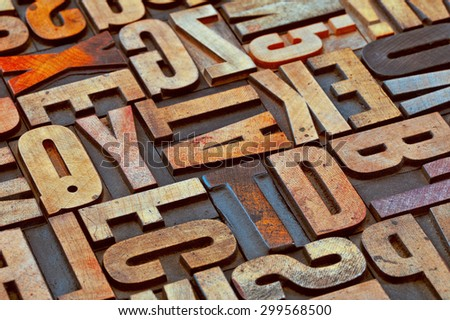 alphabet abstract in vintage letterpress wood type printing blocks stained by color inks - stock photo
