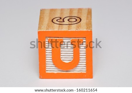 Alphabet block U isolated on a white background - stock photo