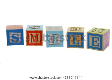 Alphabet Blocks spelling the words smile on Education - stock photo