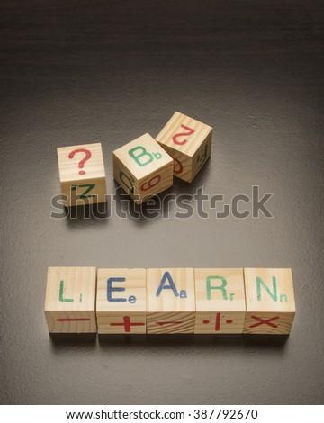 Alphabet building blocks spelling learn/Educational Alphabet Blocks/Wooden blocks arrange to spell learn - stock photo