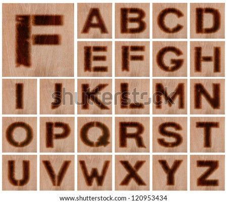 Alphabet - Collection of Letters Burnt in Wood - Isolated on White - stock photo