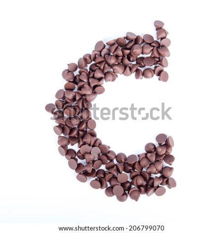 Alphabet from chocolate chips on white background - stock photo