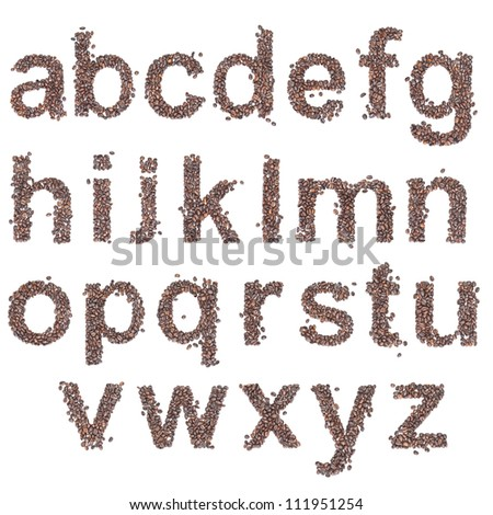 Alphabet from coffee beans on white background. - stock photo