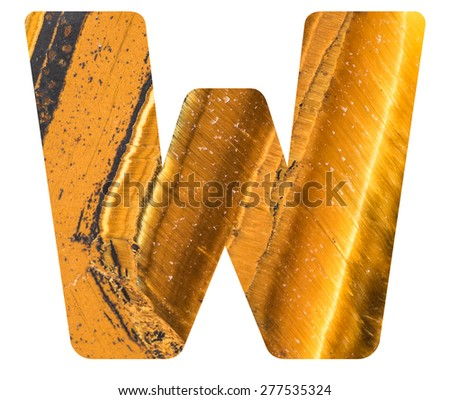 Alphabet from mineral tiger eye  isolated on white background -  letter W. - stock photo
