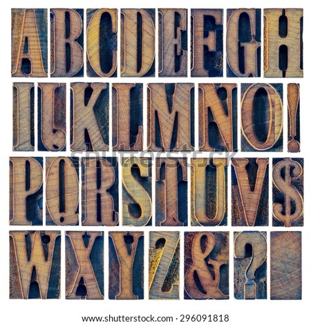 alphabet in modern letterpress wood type printing blocks, a collage of 26 isolated letters, question mark, exclamation point, ampersand and dollar sign - stock photo