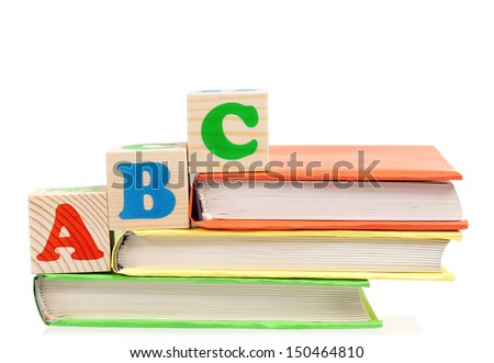 Alphabet letter ABC blocks for kids on books isolated on white background - stock photo