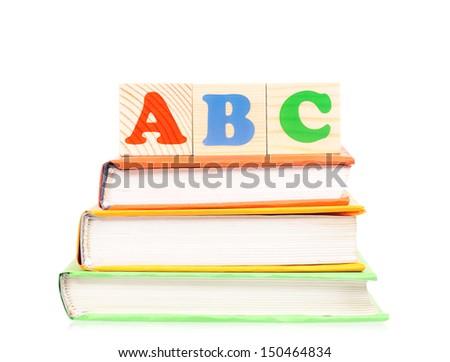 Alphabet letter ABC blocks for kids on books isolated on white background - stock photo
