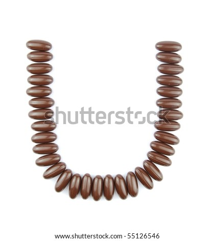alphabet letter U with chocolate candies (isolated on white background)