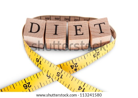 Alphabet lettering for the word Diet on wooden blocks alongside a colorful yellow tape measure in a diet