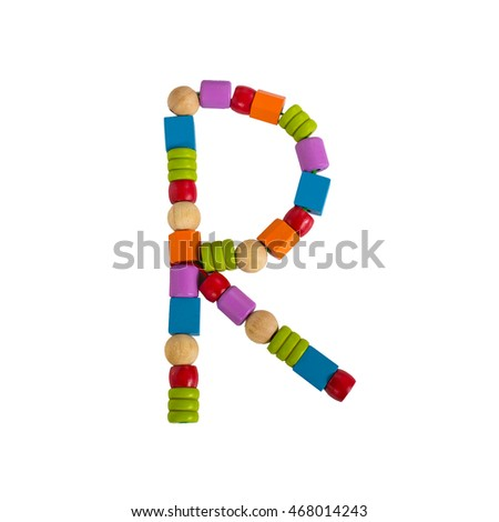 Alphabet letters of difference color wooden toy blocks isolated on white background.