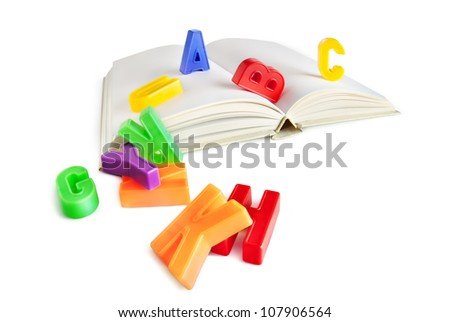 alphabet letters on a book isolated on white - stock photo