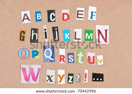 Alphabet, letters sorted on paper background