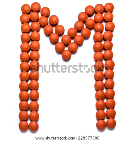 Alphabet made from medication pills. Letter M - stock photo