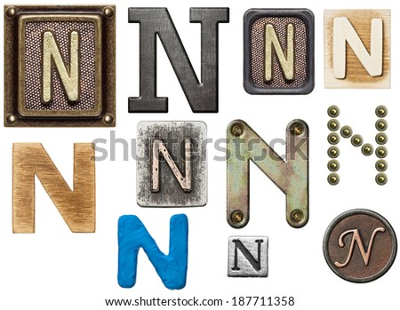 Alphabet made of wood, metal, plasticine. Letter N - stock photo