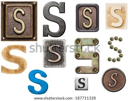 Alphabet made of wood, metal, plasticine. Letter S - stock photo