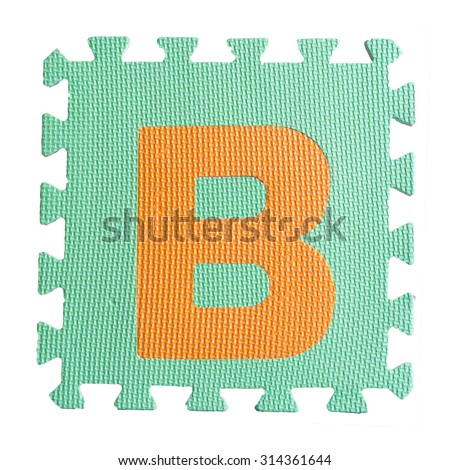 Alphabet puzzle pieces on white background - stock photo