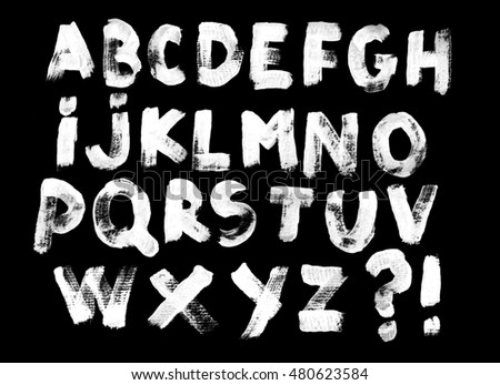 Alphabet set of white capital handwritten letters on a black background. Drawn by semi-dry brush with unpainted areas.