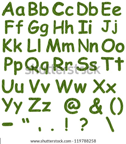 Alphabet signs and symbols, made from green leaves. - stock photo