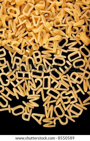 Alphabet soup letters pasta. Children's food background. - stock photo