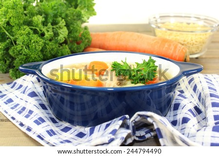 Alphabet soup with vegetables and chicken meat - stock photo