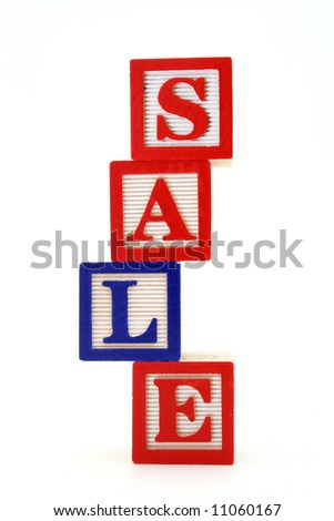 alphabet wood blocks forming the word sale