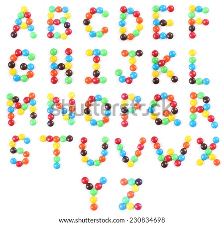 Alphabets made of chocolate candies isolated on white - stock photo