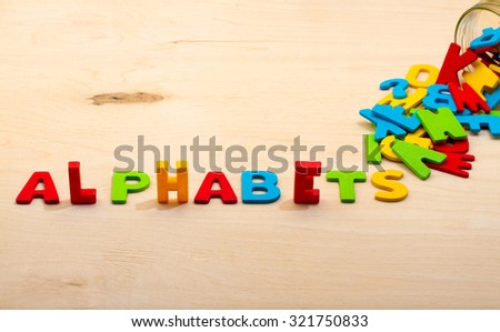 Alphabets text on wood background