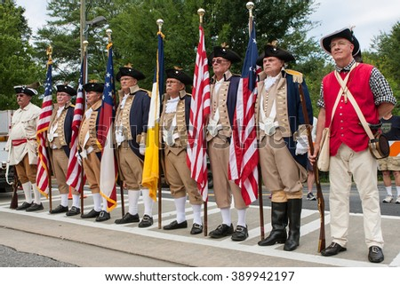 ALPHARETTA, GA - AUGUST 1:   Members of the Sons of the American Revolution stand ready to present colors at the start of the Old Soldiers Day Parade on August 1, 2015 in Alpharetta, GA .
