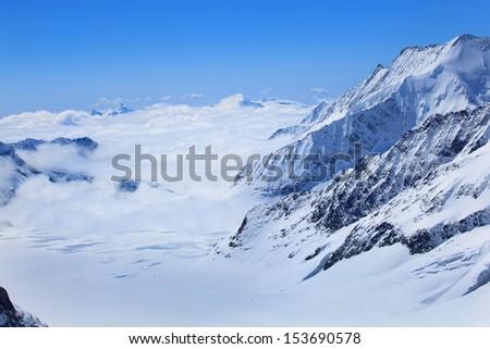 Alpine Alps mountain landscape at Jungfraujoch, Top of Europe Switzerland - stock photo