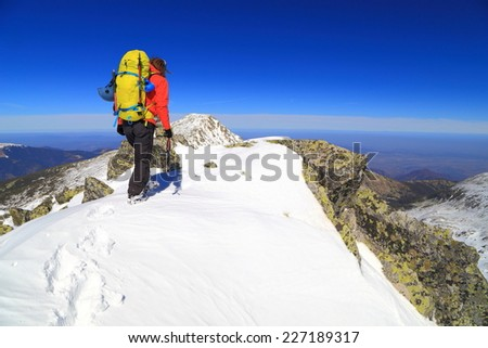 Alpine climber arrived on the summit during winter climb