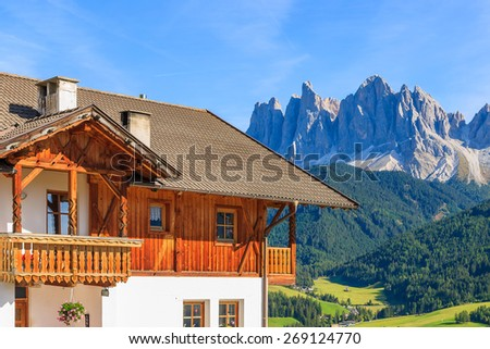Alpine house and view of beautiful mountains in Val di Funes, Dolomites Mountains, Italy - stock photo
