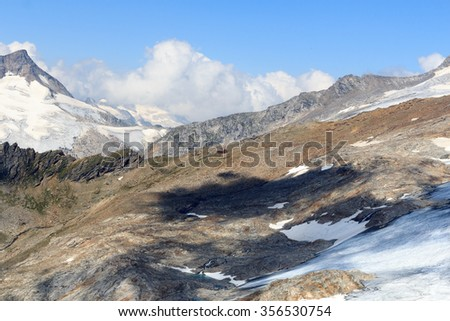 Alpine hut Defreggerhaus at Grossvenediger glacier and mountain panorama in the Hohe Tauern Alps, Austria - stock photo